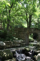 Water Cascading Under Bridge to Forest at Crespi Hicks Estate