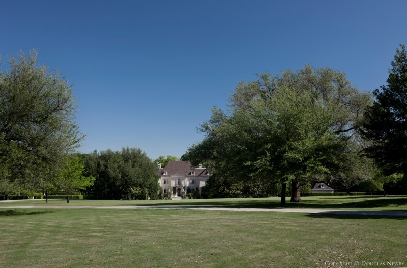 View of the Crespi Hicks Estate Home from a Sunny Meadow on the Crespi Hicks Estate Property in Dallas, Texas