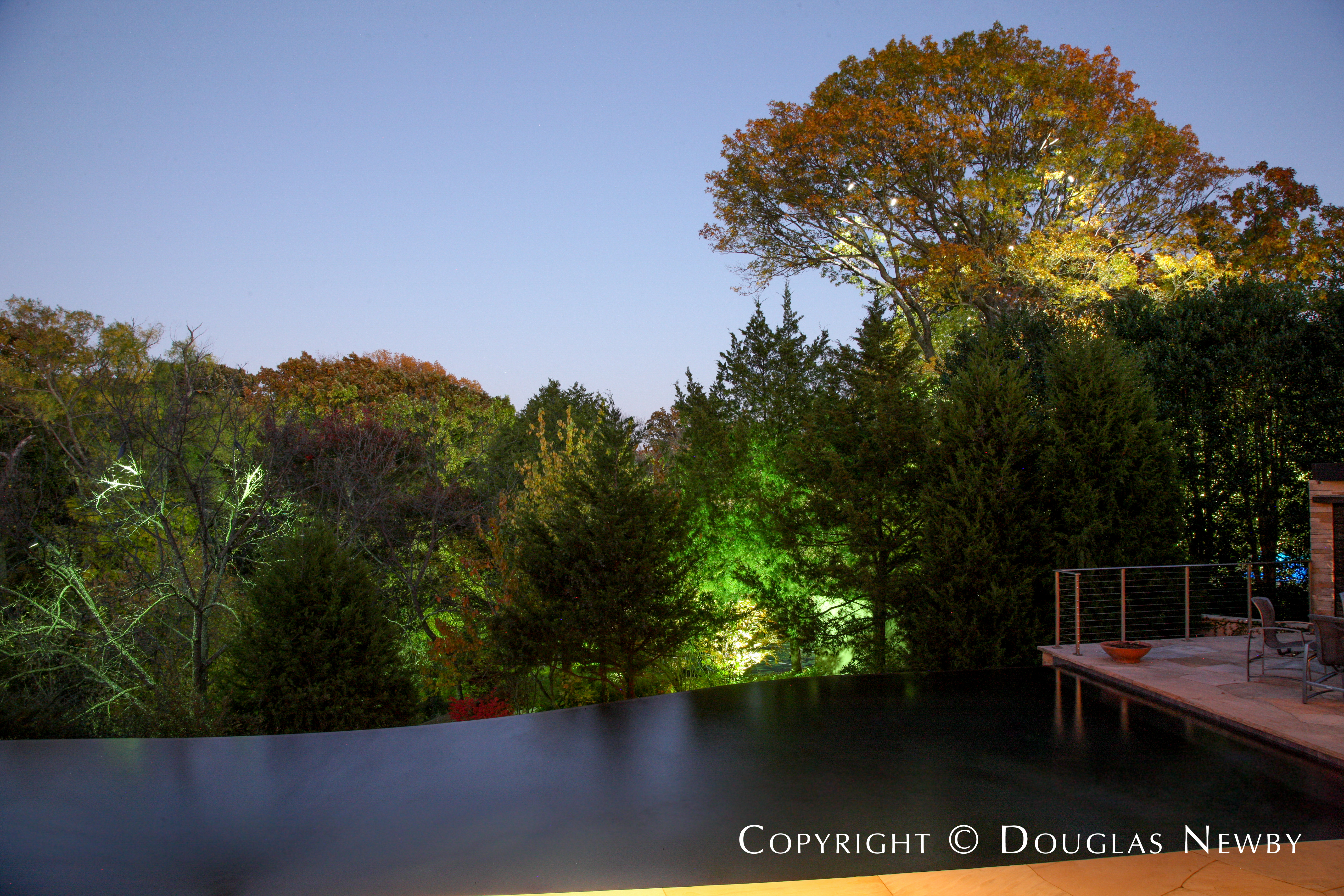 Twilight Shot of Pool From Terrace of Glen Abbey Modern Home