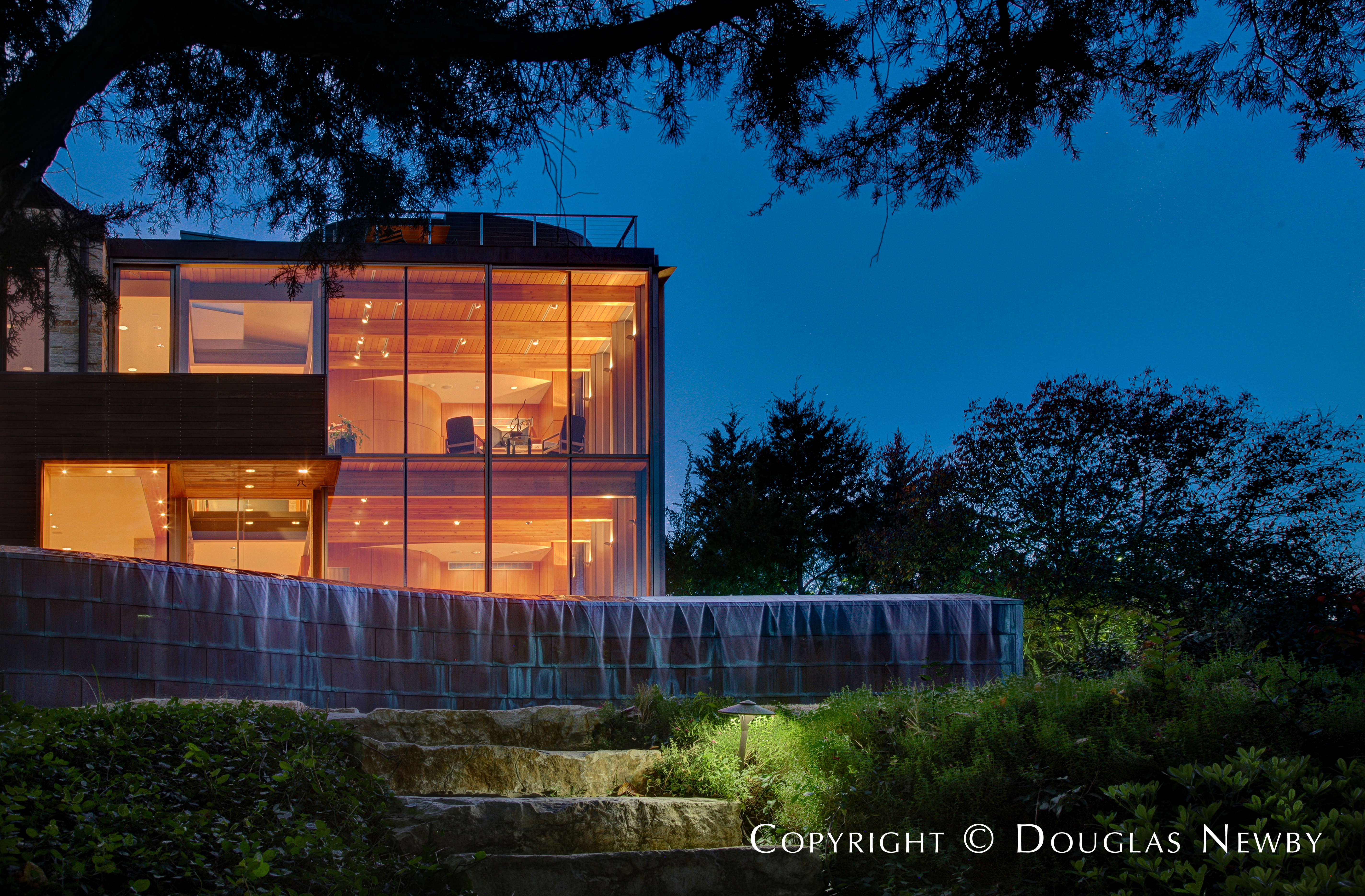 Rear Detail of Dallas Modern Home and Water Flowing From Swimming Pool