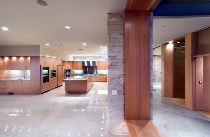 Open Kitchen with Rich Materials Designed by Oglesby Greene
