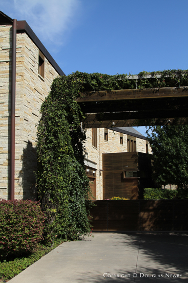 Ivy-Wrapped Trellis Over Driveway of Glen Abbey Home