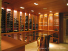 Cross Cut Redwood, Steel Rods, and Stone Floors are the Dominant Materials of This Wine Cellar With a Capacity of 2,000 Bottles