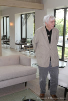 Architect David George Standing in the Interior of the Home