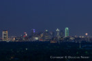View of downtown Dallas from living and dining room and balcony terrace.