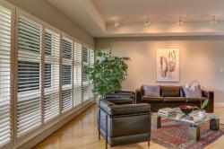 Modern Living Room Windows Provide View of Flowering Meadow