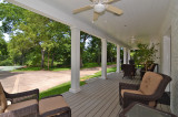 Fabulous Side Porch Overlooking Bluffview Acreage and Creek