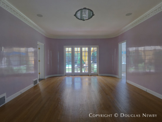 Dining Room of Lakewood Home with View of Pool and Lawn