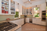 Sleek Cabinetry and Windows Define Look of Swiss Avenue Kitchen