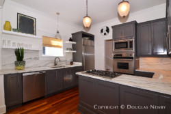 Renovated Munger Place kitchen with marble counter tops.